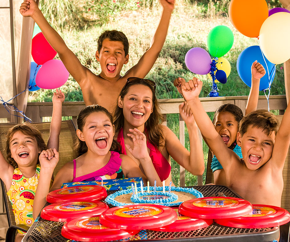 Group of kids celebrating at birthday party